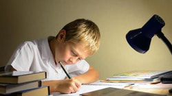 photo child-writing-with-books-and-desk-lamp-24web_zpsea6faedc.jpg